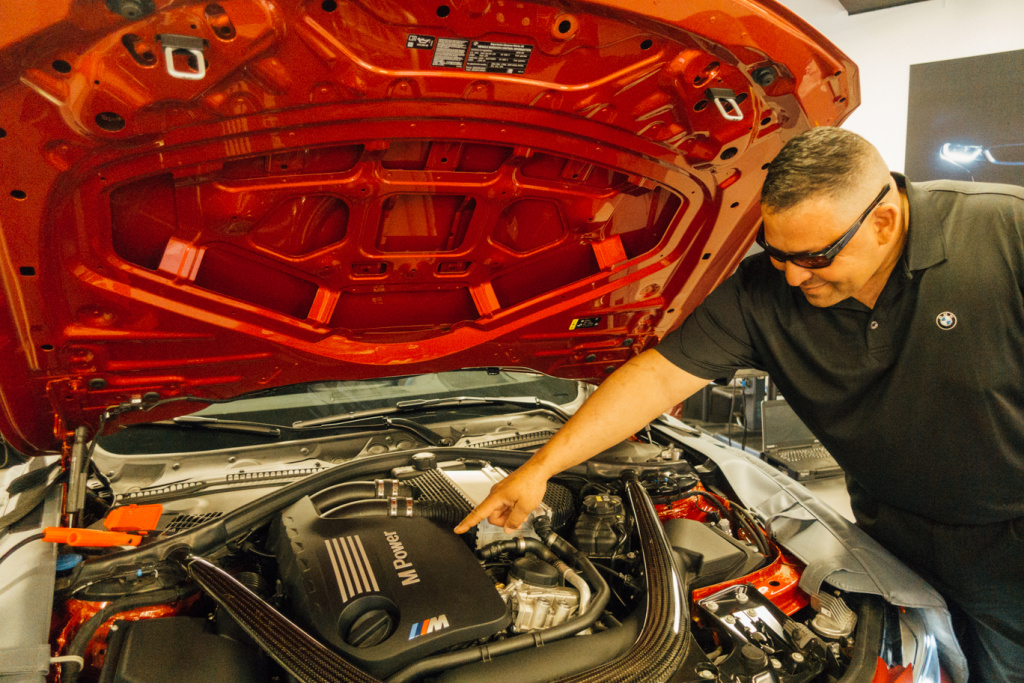 Caption: Marine Corps Master Sgt. David Lopez is a car enthusiast with 23 years in the military. He's learning to work on BMW engines as part of the inaugural class of the Military Service Technician Education Program at Camp Pendleton., Credit: Libby Denkmann/American Homefront