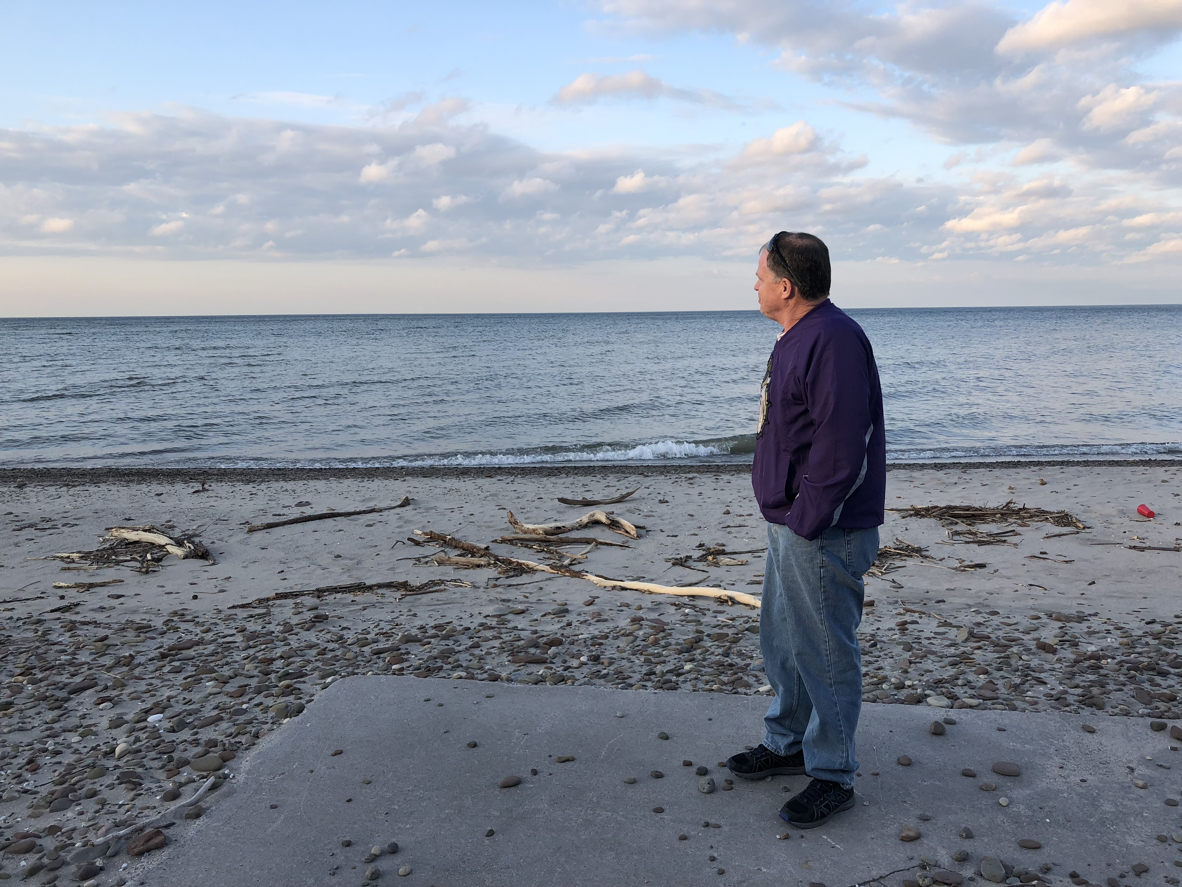 Caption: Bobby Jones stand on the site of his old patio, which is now partially buried by last year's floods., Credit: Veronica Volk, Great Lakes Today