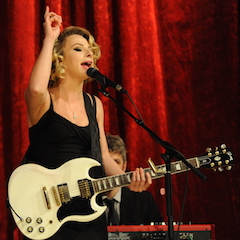 Caption: Samantha Fish rocks the WoodSongs Stage.