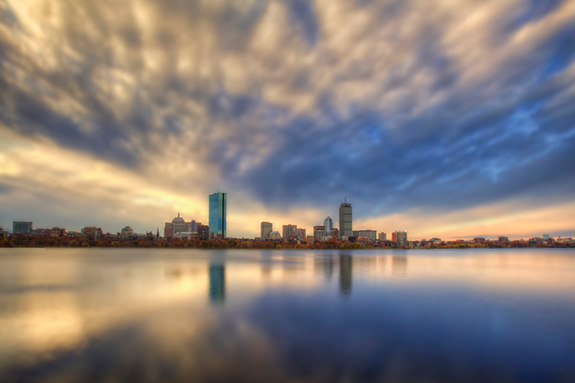Caption: Boston's Back Bay sits large in the frame on a partly cloudy early morning as a few tall buildings grow off the water., Credit: Justin Jensen/Flickr