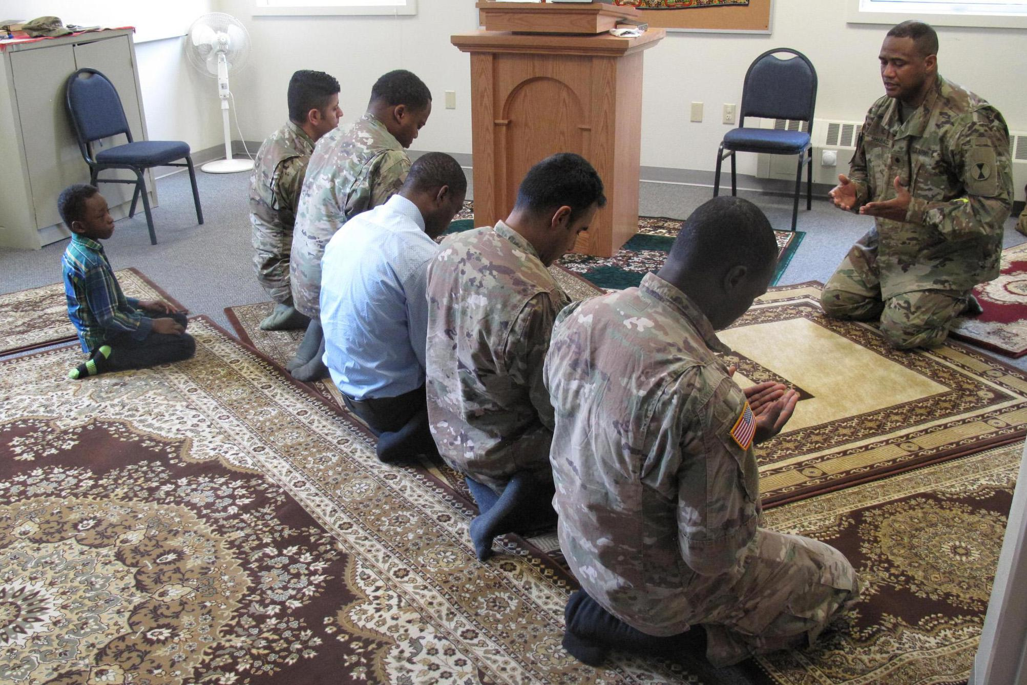 Caption: Lt. Col. Khallid Shabazz leads Friday prayer for the Muslim community of Joint Base Lewis-McChord. Shabazz is the Army's first division-level Muslim chaplain., Credit: Anna Boiko-Weyrauch / American Homefront