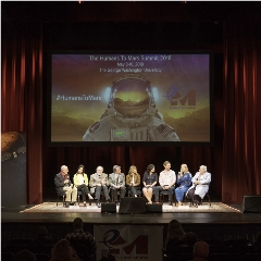 "Caption: ""Why Mars?"" closing panel at the 2018 Humans to Mars Summit.  (l. to r.) Mat Kaplan, Saralyn Mark, Jeff Bingham, Jim Garvin, Keri Kukral, Janey Ivey, Nicholas Agnew, ""Astronaut Abby,"" Artemis Westenberg, Credit: ©CherylNemazie.com"