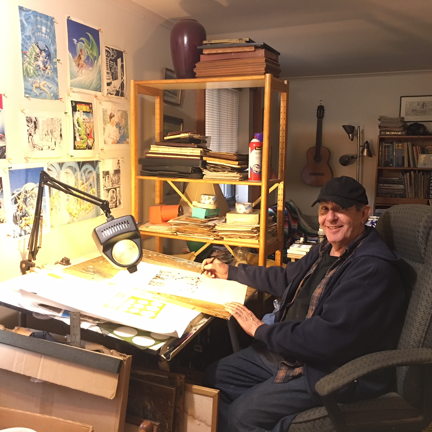 Caption: A portrait of Ralph Reese at his drawing desk in his apartment in April 2018. , Credit: Catherine Saint Louis
