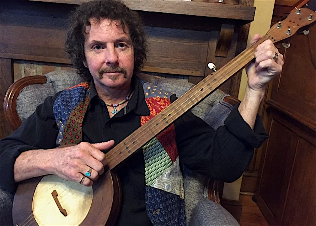 Caption: Rick Ward, banjo maker, player, and ballad singer, of the Beech Mountain community in western North Carolina.  Here he's holding a traditional mountain banjo he and his father made from parts found in Rick's grandfather's shop.  Rick is among the performe, Credit: Paul Brown