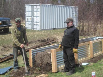 Caption: Grand Portage Agriculture Coordinator Andy Schmidt and helper Dennis Westerlind working on the Elder's raised garden bed