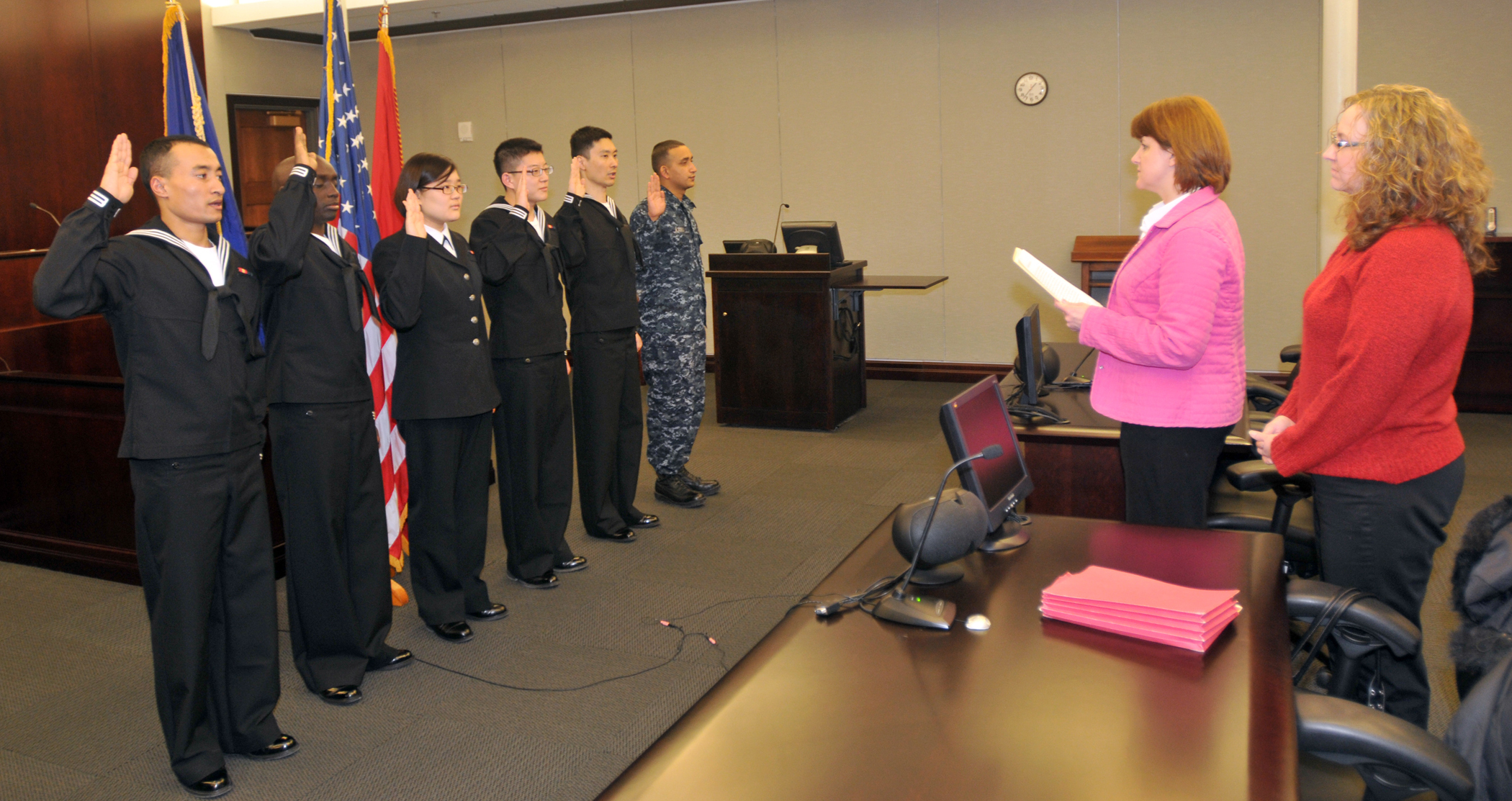 Caption: The first Navy sailors to participate in the MAVNI program take their oath of citizenship in this 2010 file photo. MAVNI has been controversial since it began in 2008., Credit:  Scott Thornbloom / U.S. Navy
