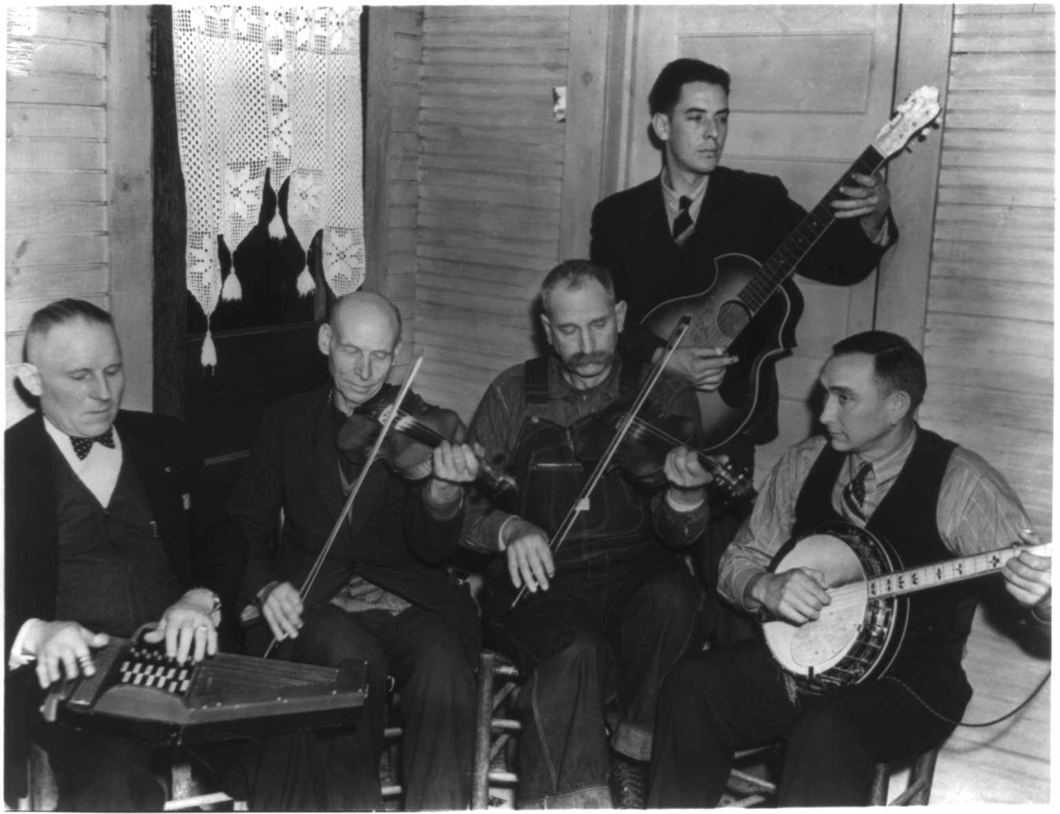 Caption: The Bogtrotters were a Galax, Virginia-area band – shown here in 1937 – active in the early years of the Galax Old Fiddlers' Convention, which was founded in 1935.  (L-R Doctor W.P. Davis, Uncle Alec Dunford, Crockett Ward, Fields Ward, Wade Ward) This we, Credit: Library of Congress, Alan Lomax Collection.