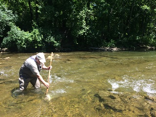 Caption: Peter Lent in Oatka Creek , Credit: Caitlin Whyte, WXXI