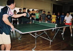 Caption: Students watch as their teachers--former ping pong champions from China, demonstrate their skills, Credit: Heidi Chang