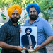 Caption: Rana Sodhi (L) and Harjit Sodhi hold a photograph of their late brother, Balbir Singh Sodhi, who was shot and killed at 52. Since his death, the brothers have been involved in educating others about Sikhism and the discrimination their community faces in , Credit: Mia Warren