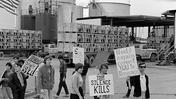 "Caption: April, 1967, Redwood City. Students picket at a napalm bomb factory. ""The Harvey Richards Media Archive."" © Paul Richards."