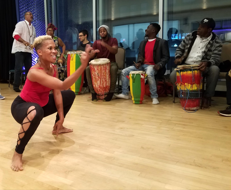 Caption: Djenane Saint Juste of Afoutayi Dance, Music, and Arts Company., Credit: Anna Stitt