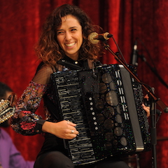 Caption: Youssra El Hawary from Egypt on the WoodSongs Stage.