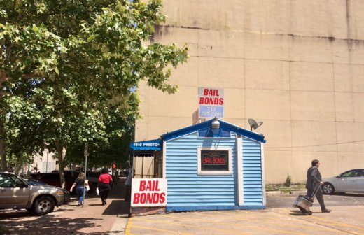Caption: A bail bonds agency welcomes business next door to the Harris County District Attorney's Office. A federal judge recently ruled the county's bail practices unconstitutional. , Credit: Ruxandra Guidi