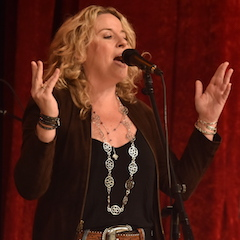 Caption: Amy Helm on the WoodSongs Stage.