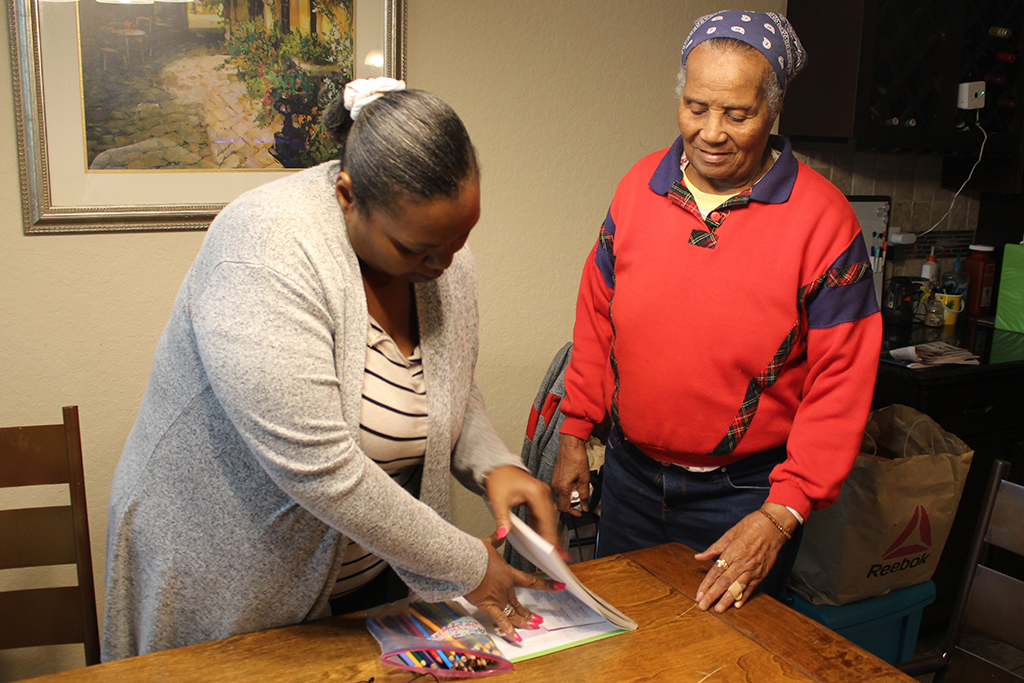 Caption: At a medical foster home near San Antonio, caregiver Tiffany Graves (left) sets out art supplies for Rose Witherspoon, a World War II veteran., Credit: Carson Frame/American Homefront