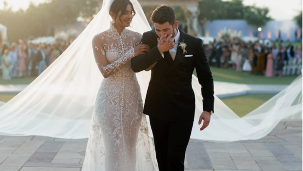 Caption: Priyanka Chopra and Nick Jonas at thier wedding