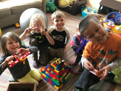Caption: Some of the children that Maria Carlson cares for at Wee Folks Daycare