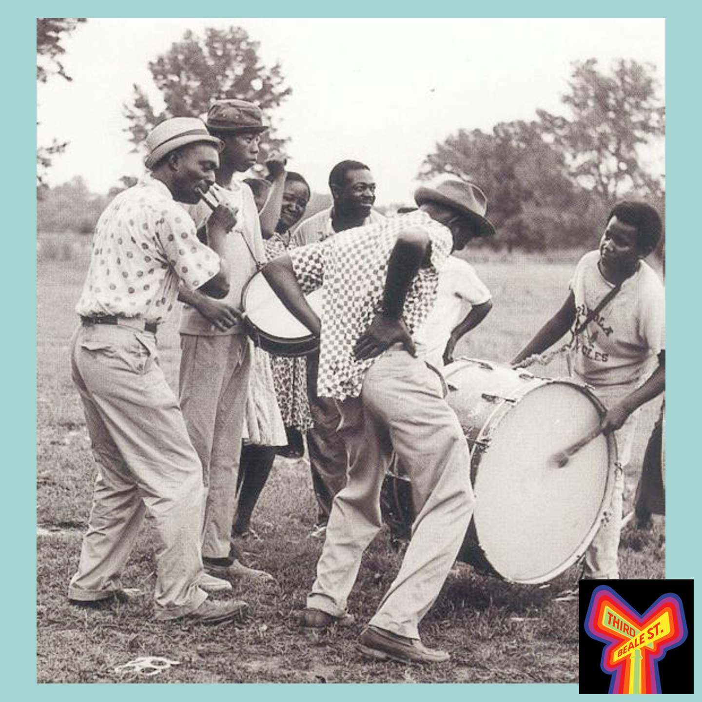 Caption: Napoleon Strickland on fife, Jimmie Buford on bass drum, R.L. Boyce on snare drum, and Othar Turner dancing. Photo by David Evans.