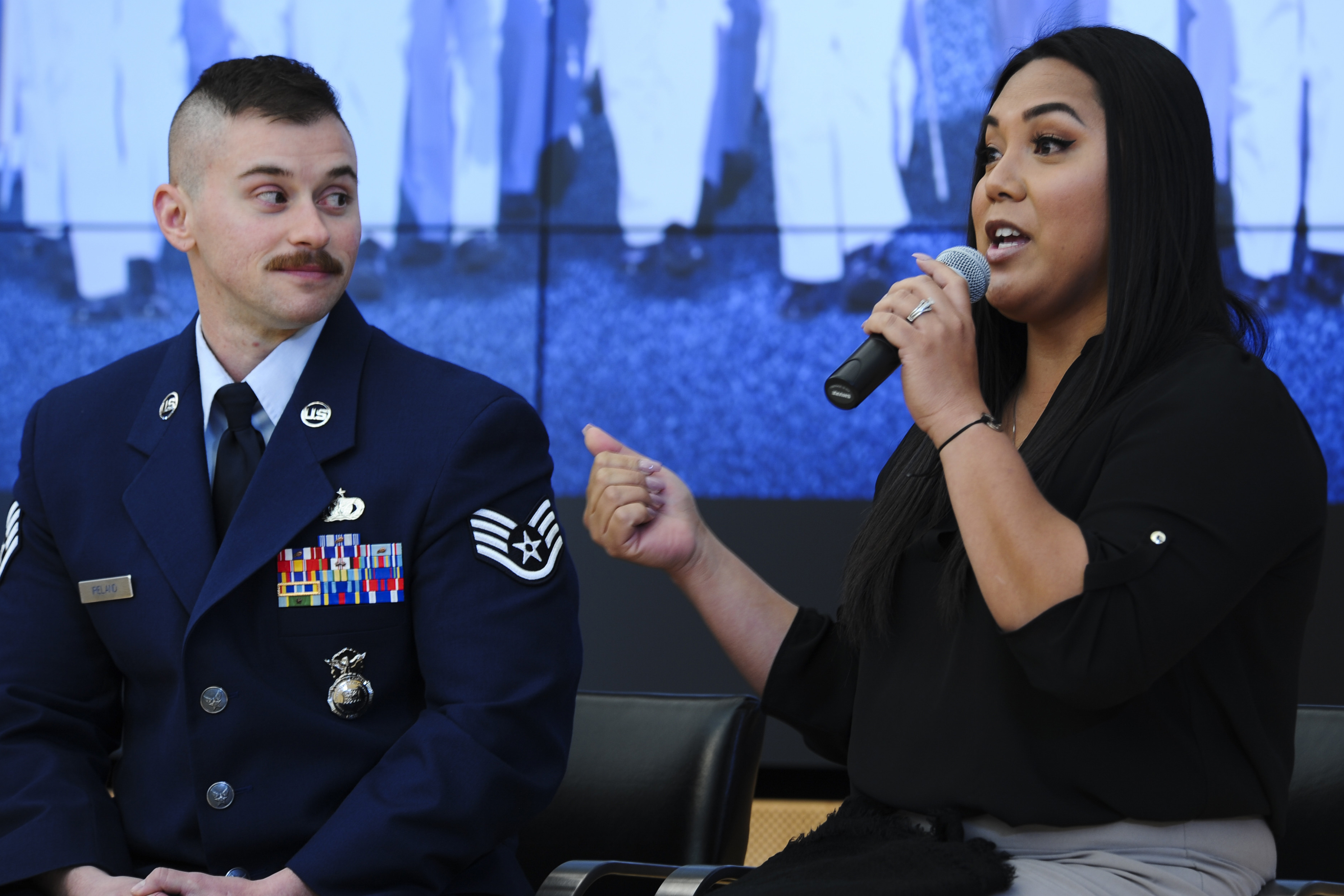 Caption: Staff Sgt. Logan Ireland and his wife, Laila, speak about transgender issues at the U.S. Air Force Academy in February 2018., Credit: Julius Delos Reyes / American Homefront