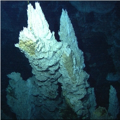 Caption: CALCIUM CARBONATE SPIRE IN THE LOST CITY HYDROTHERMAL FIELD, Credit: IFE / URI-IAO / UW / Lost City Science Party / NOAA / OAR / OER