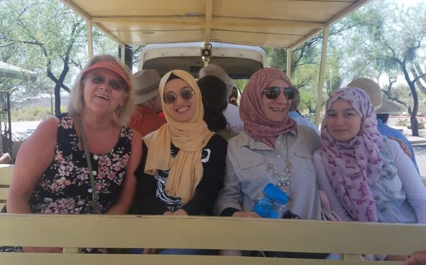 Caption: Houda, her mom and sister, and their friend Mishelle on the tram in Sabino Canyon