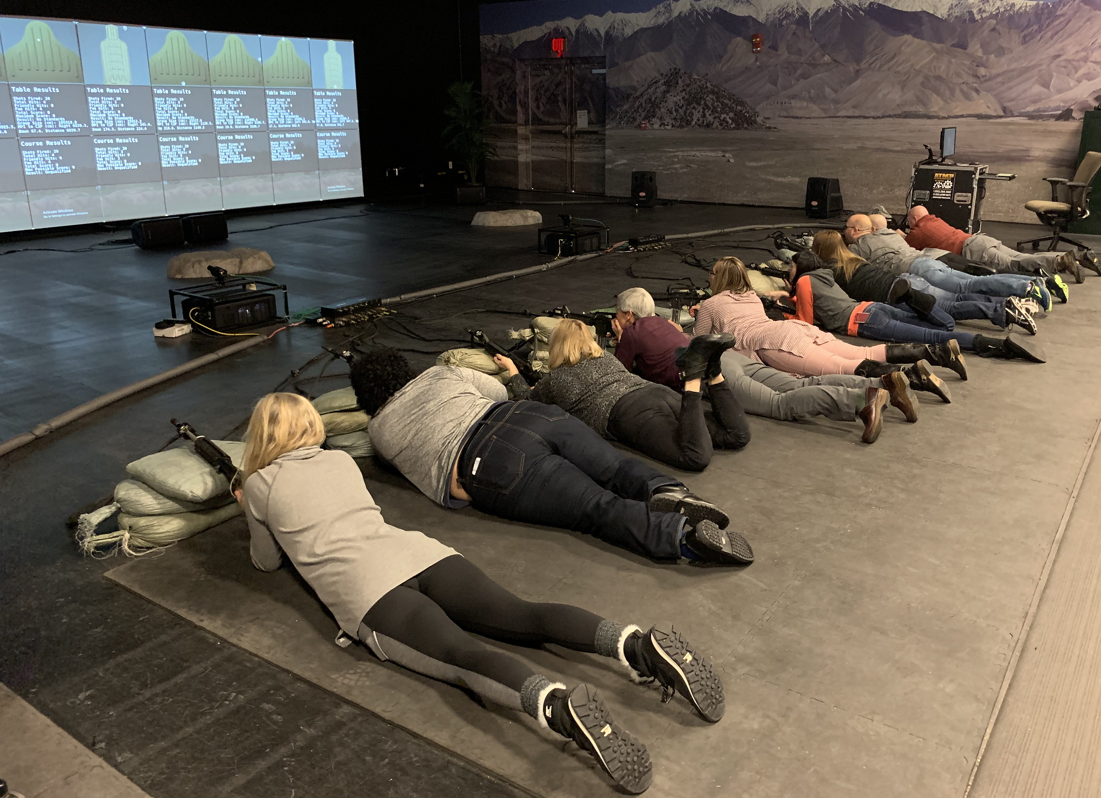 Caption: High school educators take part in a virtual firing range exercise as they tour Fort Carson, Col. Army leaders hope these tours will result in educators steering more students toward military service., Credit: Dan Boyce / American Homefront