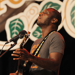 Caption: Blues master Cedric Burnside on the WoodSongs Stage.