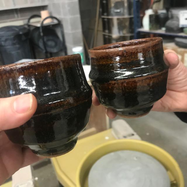 Caption: Warren MacKenzie, tenmoku cups in the collection of UMD Professor of Ceramics, Liz James, Credit: Maija Jenson