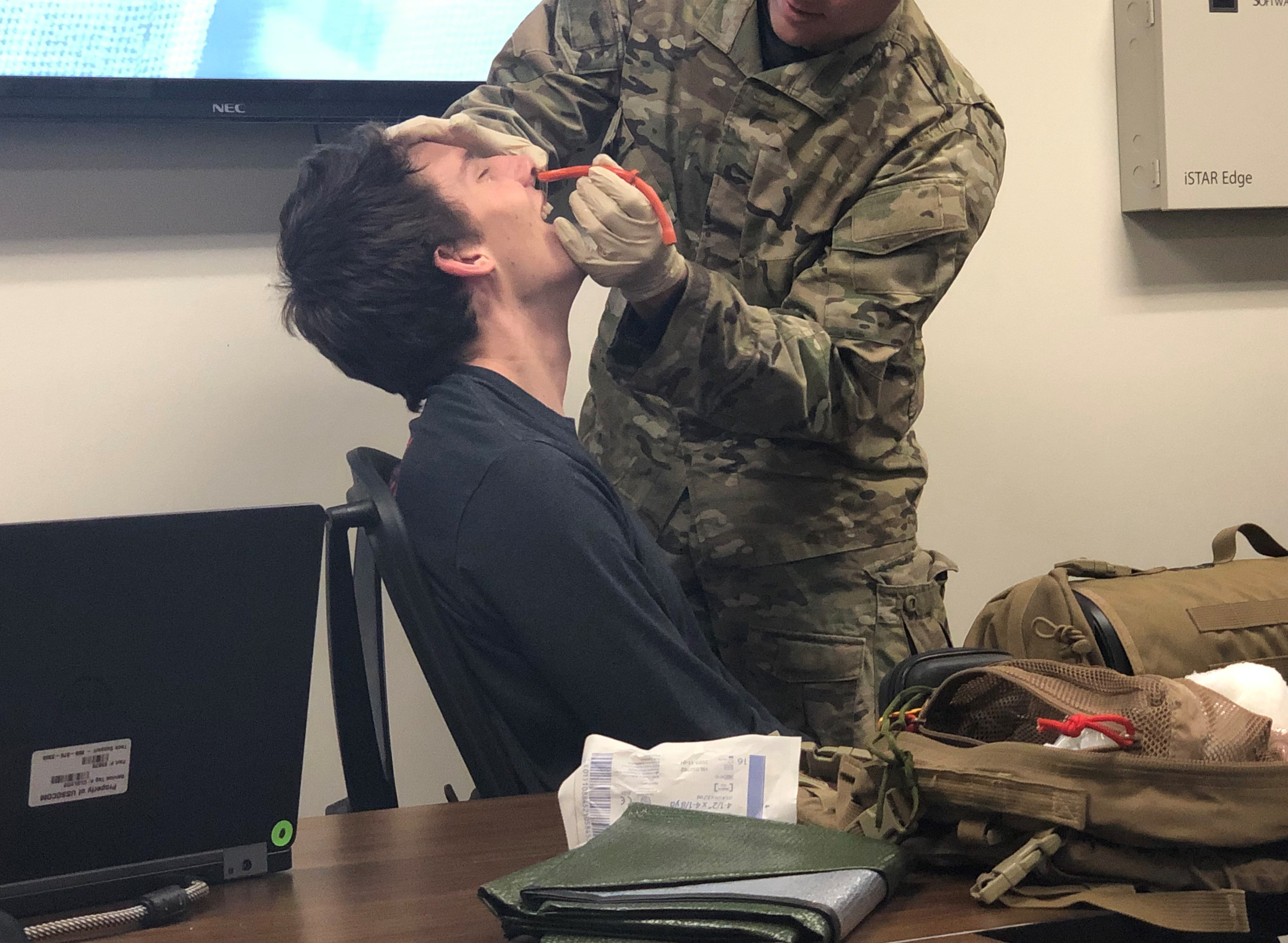 """Caption: Duke graduate engineering student Matt Hawkins volunteers for a demonstration of a nasal ventilation tube during a class called """"Hacking for Defense."""", Credit: Jay Price/American Homefront"""