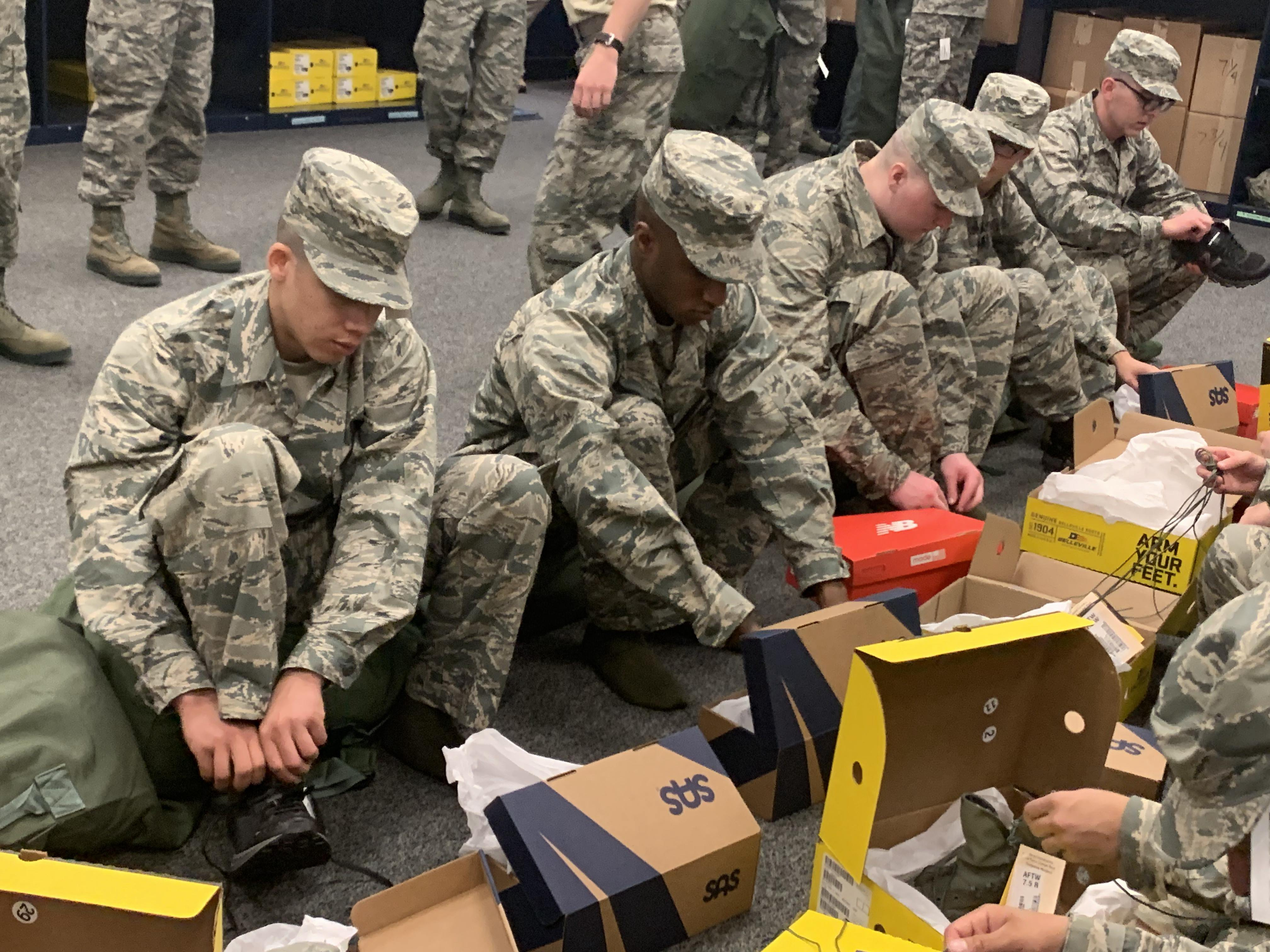 Caption:  New Air Force recruits try on shoes from San Antonio Shoemakers, Propper Footwear, and New Balance. Since January, the Defense Department has been issuing the shoes free of charge., Credit:  Ruth A. Medina-Villanueva / U.S. Air Force