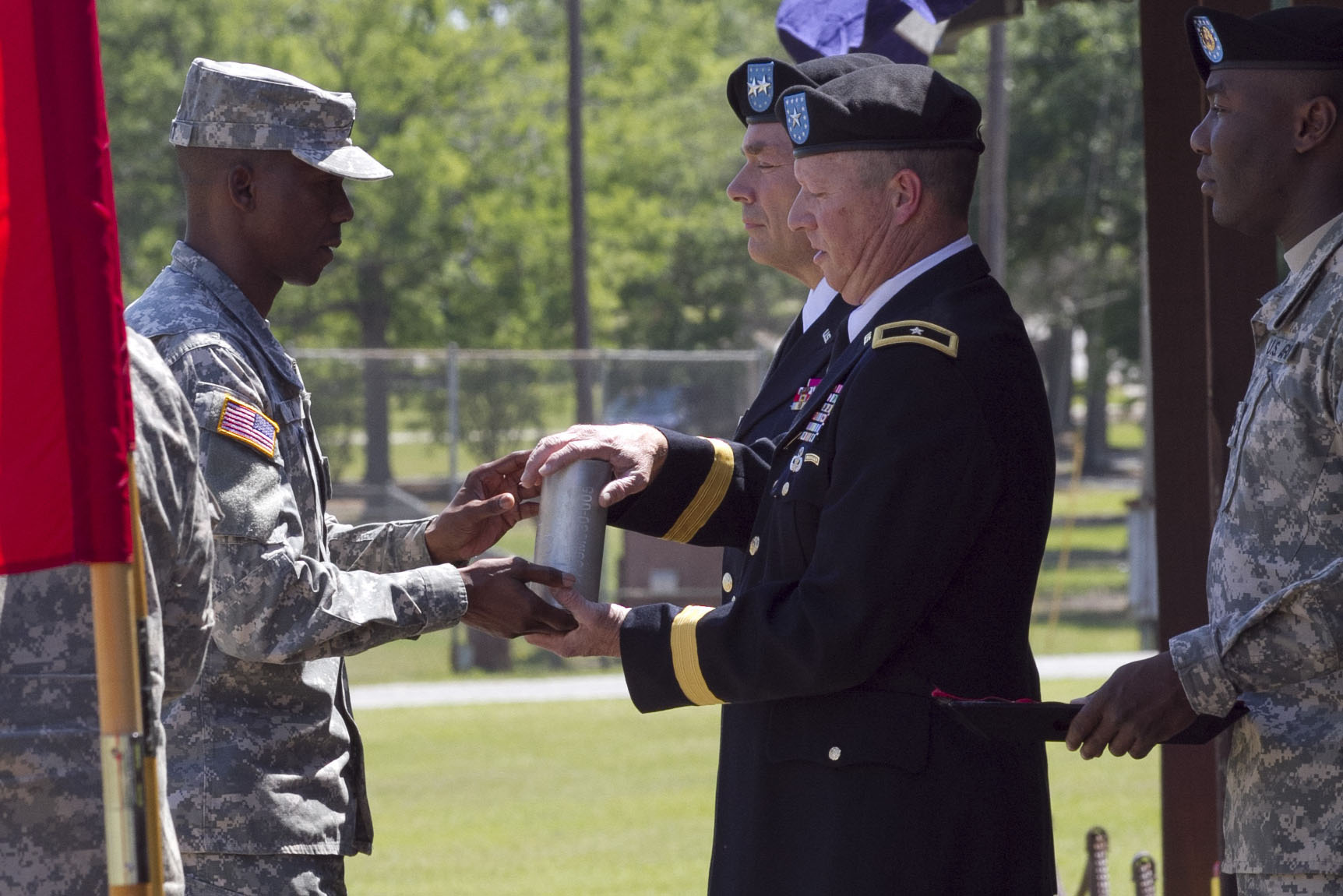Caption: Gen. William J. Gothard (right) receives a spent shell casing as part of his 2014 retirement ceremony at Fort Jackson, S.C. Gothard says his 36 years of service left him with hearing loss and tinnitus., Credit:  Shantelle Campbell / U.S. Army