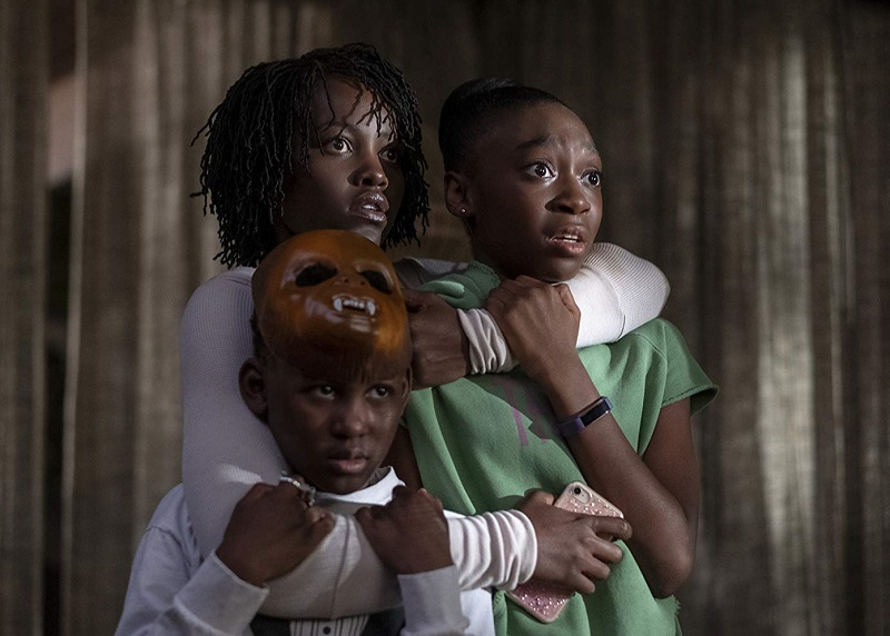 Caption: Lupita Nyong'o, Evan Alex, and Shahadi Wright Joseph in Jordan Peele's 'Us'