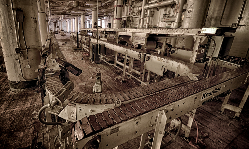 Caption: Conveyor belts in abandoned Wrigley gum factory.