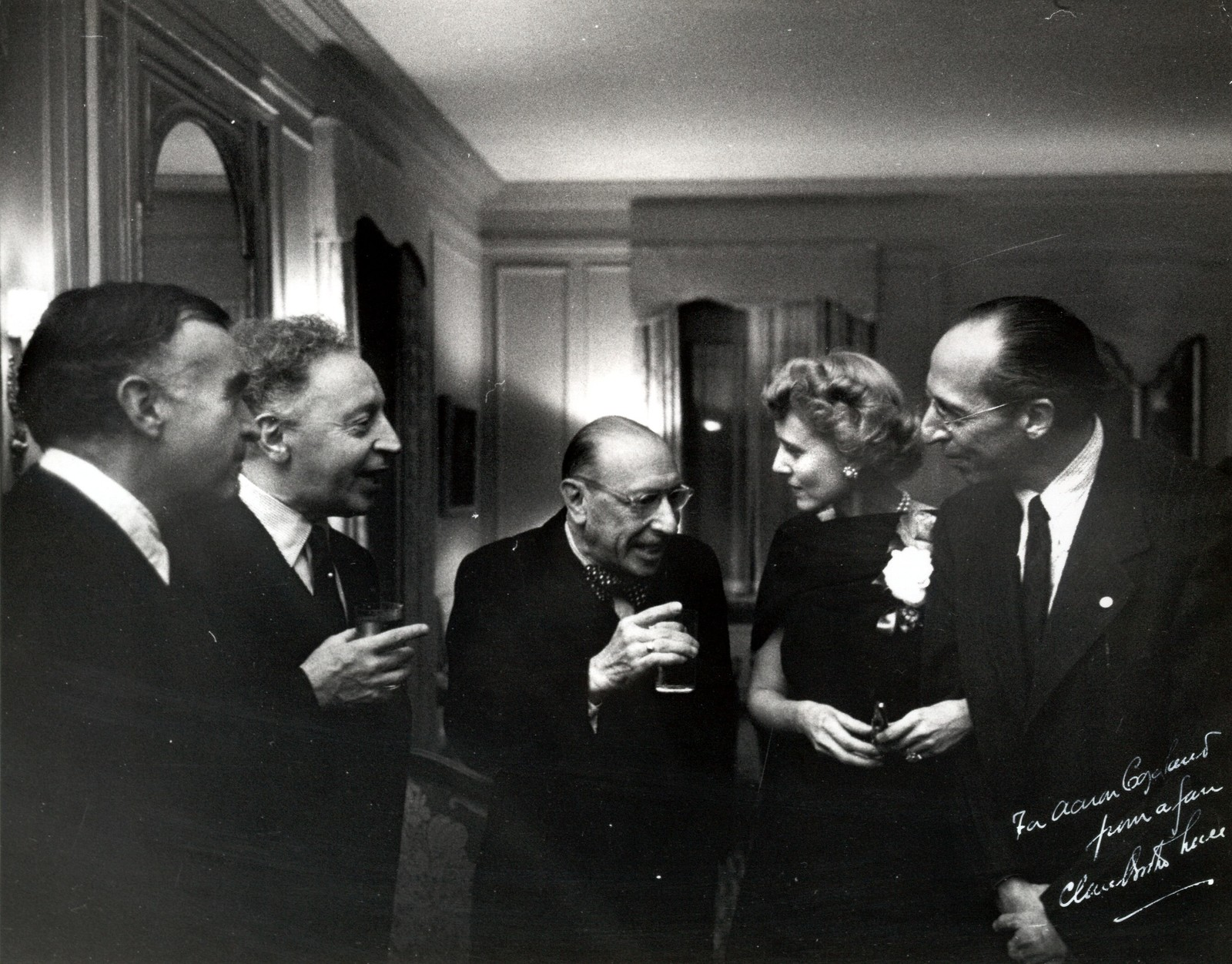 Caption: Carlos Chávez with Artur Rubinstein, Igor Stravinsky, Claire Booth Luce, and Aaron Copland
