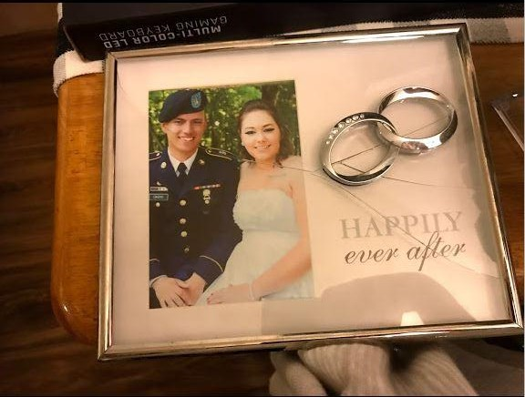 Caption: Christopher and Andrea Cacho's wedding picture was among the many possessions damaged when the Army moved them from Kentucky to Virginia., Credit: Andrea Cacho