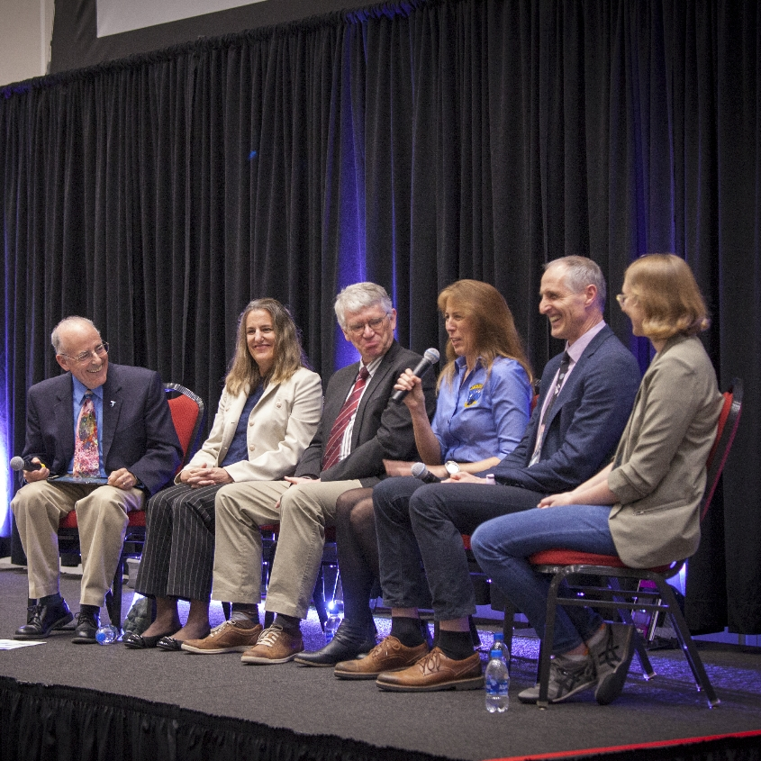Caption: Mat Kaplan and his Planetary Radio Live panel at the Planetary Defense Conference public event.  From left to right:  Mat, Nancy Chabot, Gerhard Drolshagen, Kelly Fast, Rüdiger Jehn, and Carrie Nugent, Credit: Antonio Peronace for The Planetary Society