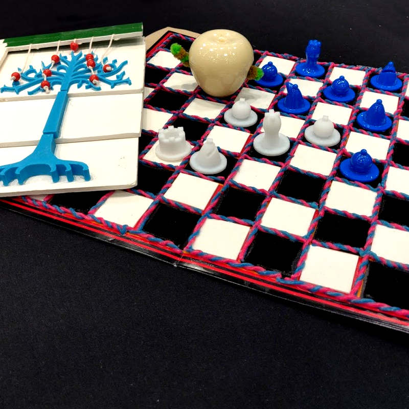 Caption: Picture book and a chessboard designed by participants in the Build a Better Book project, as shown during SXSW. Both were designed to preserve function and aesthetics even when the reader or player can't see., Credit: Pius Wong