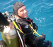 Caption: Chris Martens getting ready to 'splash' and dive 50 feet underwater to live in the Aquarius Undersea Laboratory for a 10-day mission., Credit: Mark Hulsbeck