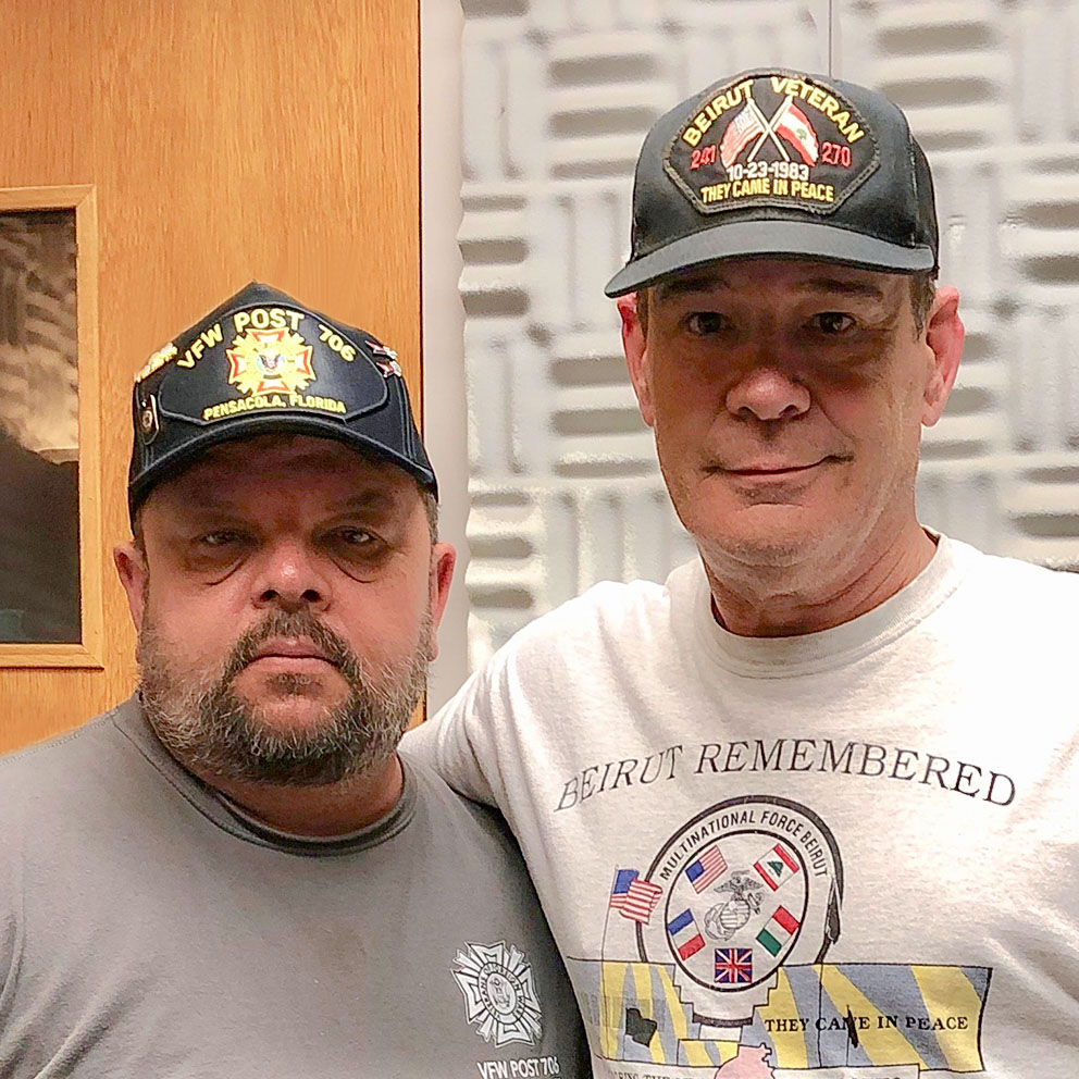 Caption: Mike Cline and James Edward Brown pose at their StoryCorps interview on April 30, 2019 in Pensacola, FL. By Joseph Vincenza/WUWF.