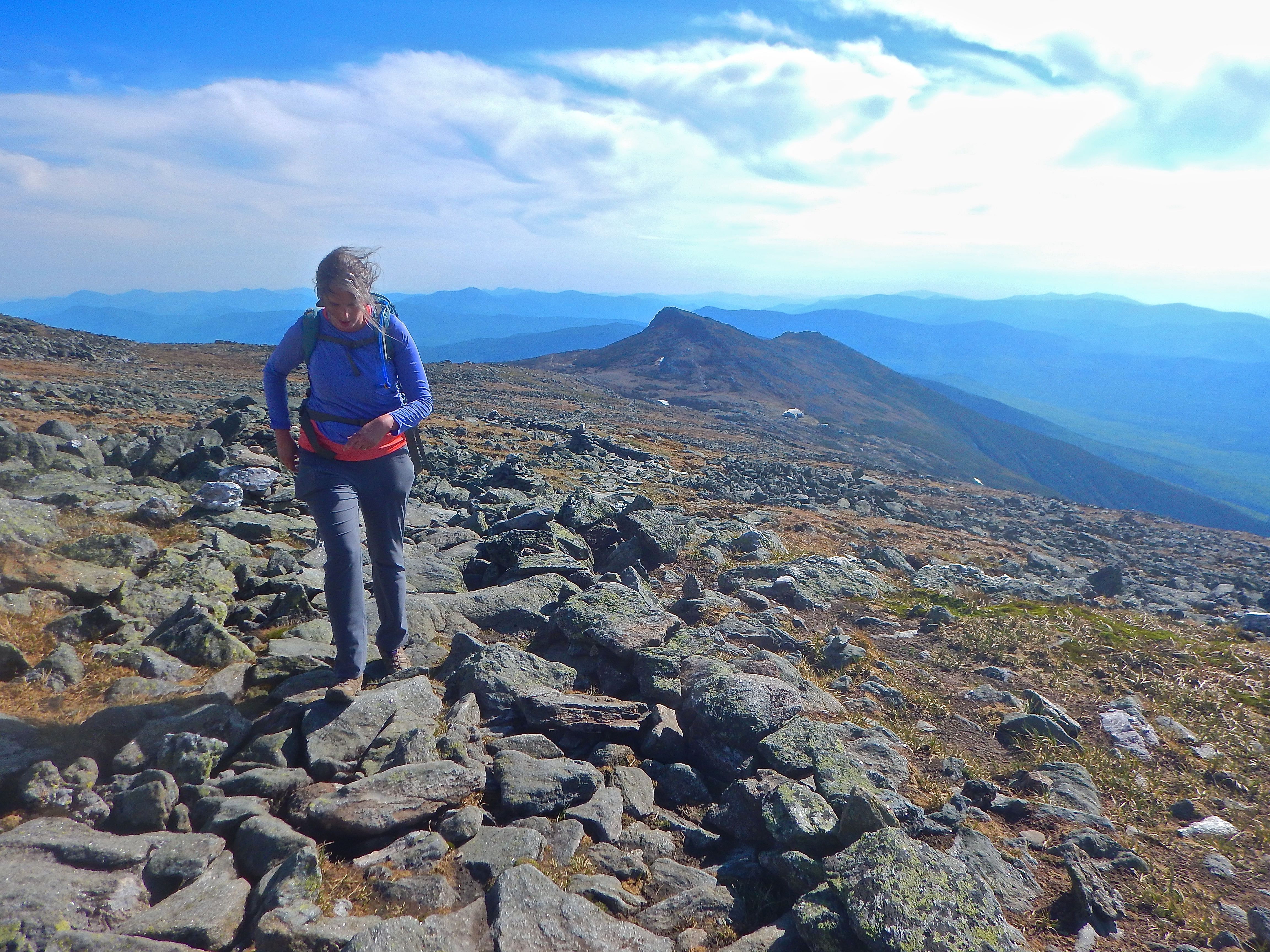 Caption: My wife Juliana choosing to go big in New Hampshire's Presidential Range, Credit: Brian Aust