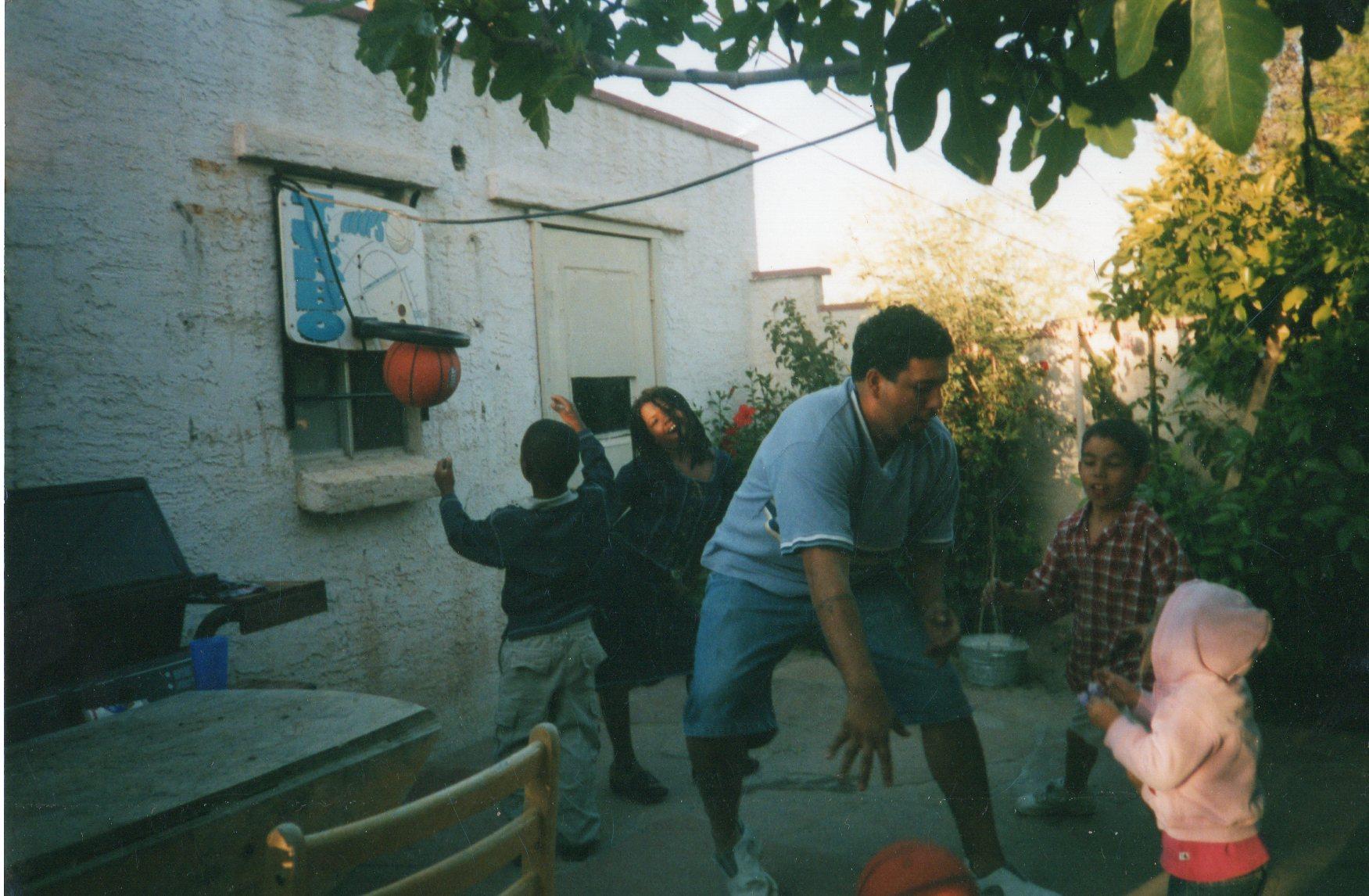Caption: Tio Ray Plays With the Kids, Credit: Jacqui Zazueta