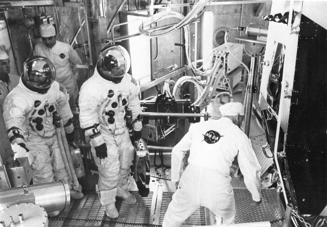 Caption: Apollo 11 back up crew members Fred Haise (left) and Jim Lovell prepare for an altitude test in the lunar module preparing for Apollo 11.
