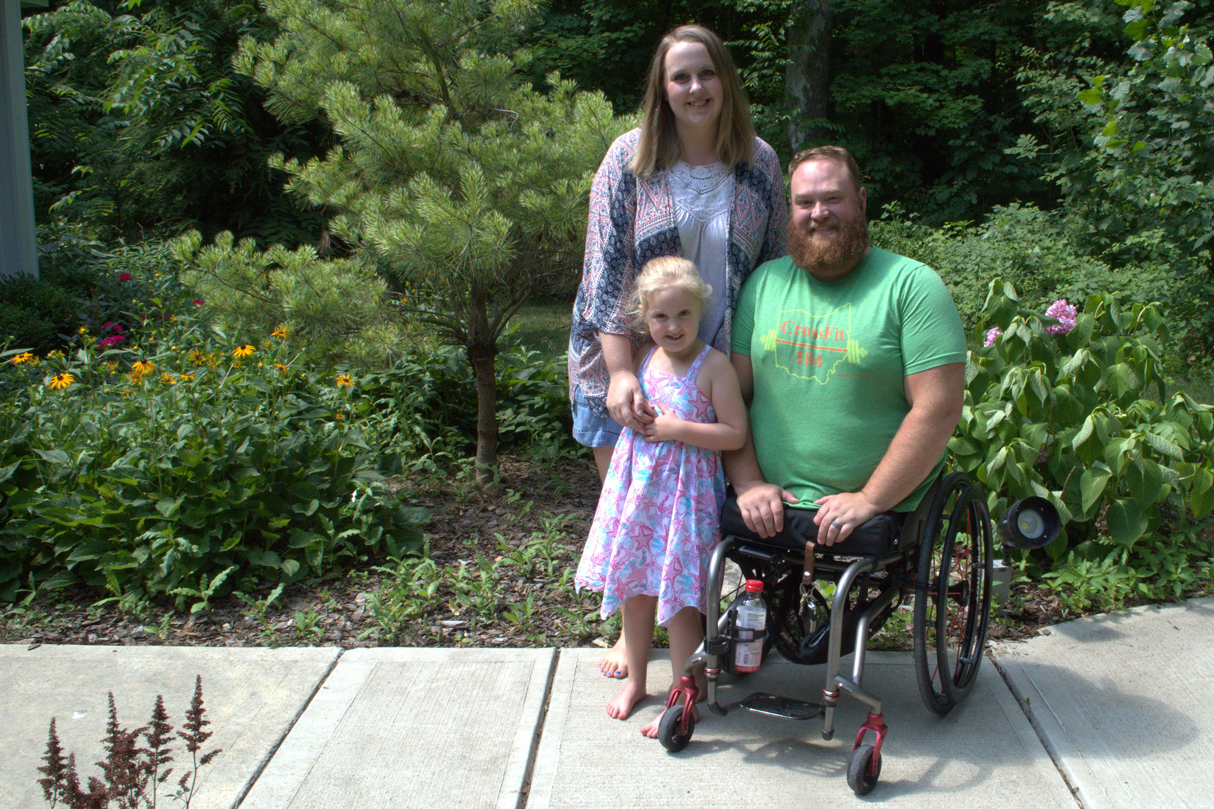 Caption: Army veteran Jason Gibson and his wife Kara paid out of pocket for IVF treatments that resulted in the birth of their daughter Quinn. Gibson lost both legs in an IED explosion in Afghanistan., Credit: Paige Pfleger / American Homefront
