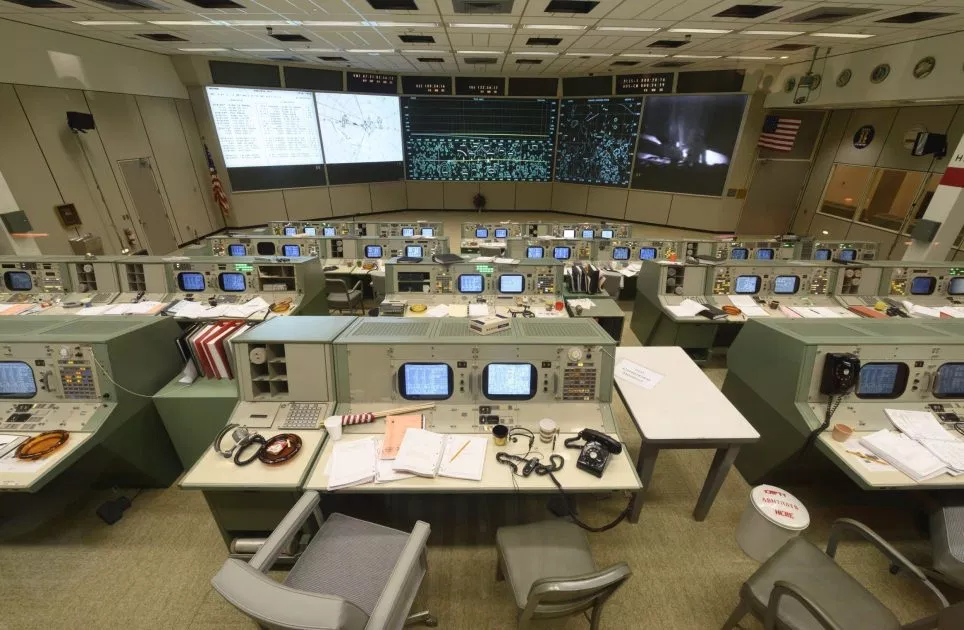 Caption: The newly restored Mission Operations Control Room 2 and the view from where Dr. Kraft would sit.
