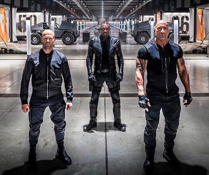 Caption: Jason Statham, Idris Elba, and Dwayne Johnson in 'Fast & Furious Presents: Hobbs & Shaw' (2019)