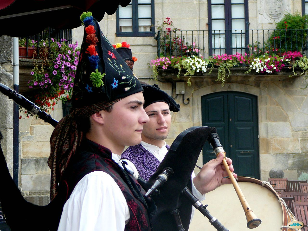 Caption: Gaieteros (Galician Bagpipers)