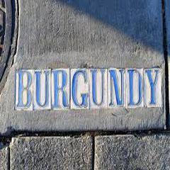 Caption: Burgundy Street sign