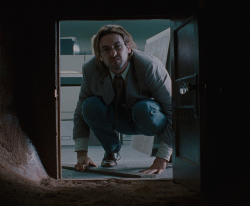 Caption: John Cusack in 'Being John Malkovich' (1999)