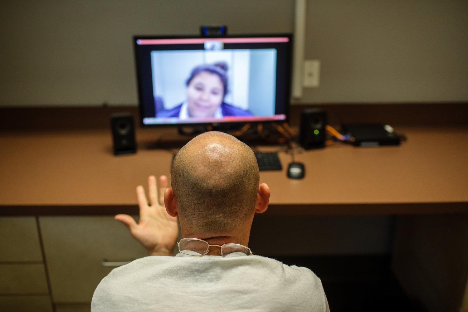 Caption: A patient video conferencing with a medical provider at Ideal Option the clinic in Everett, WA., Credit: Leah Nash for Finding Fixes